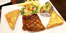 Chicken Grill Steak Set Has Baked Potato With Butter, Vegetable Salad, French Fried And Bread Butter Toast
