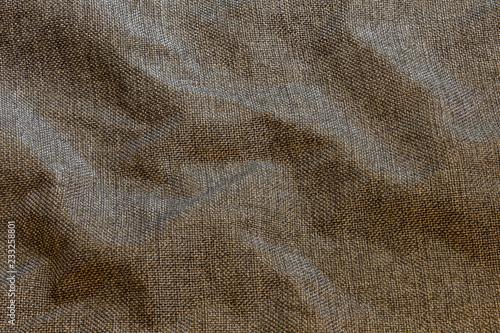 Fotografie, Obraz  Brown crumpled dense rough fabric closeup background