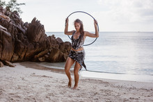 Girl At The Beach With Hula Hoop