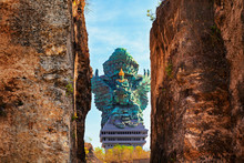 Landscape Picture Of Garuda Wisnu Kencana GWK Statue As  Bali Landmark With Blue Sky As A Background. Balinese Traditional Symbol Of Hindu Religion. Popular Travel Destinations In Indonesia.