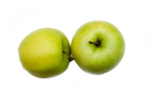 Two Yellow Apples On A White B...