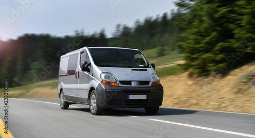 Obraz commercial van drive by mountain road - fototapety do salonu
