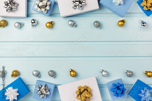 Fototapety, obrazy: Copy Space on a light blue background. Blue and white gift boxes are laid out around it. Silver and gold decorative balls.