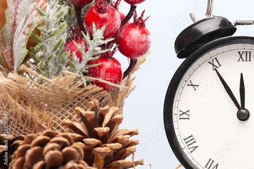 Fotografia  Composition of clock and christmas decorations on bright background