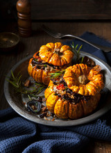 Two Small Pumpkins With A Vege...