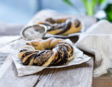 A Braided Yeast Dough Wreath Filled With Poppy Seeds