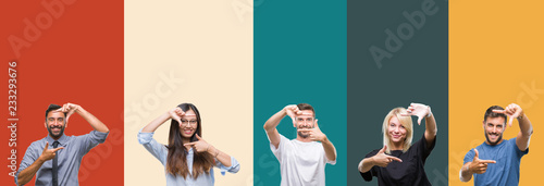 Fotografiet  Collage of different ethnics young people over colorful stripes isolated background smiling making frame with hands and fingers with happy face
