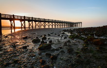 Overview Of Beautiful Fishing Pier At Sunrise At Low Tide At Walnut Beach, Milford Connecticut, USA. Walnut Beach Is A Great Place To Spend The Day Strolling Along The Edge Of The Long Island Sound.