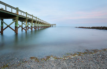 Overview Of Beautiful Fishing Pier After Sunset At Low Tide At Walnut Beach, Milford Connecticut, USA.