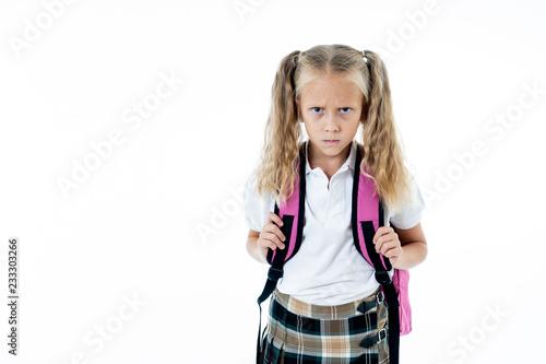 Sad little girl in school uniform carrying a big backpack feeling overwhelmed an Canvas-taulu