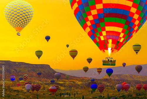 Hot air balloons basket landing in a mountain