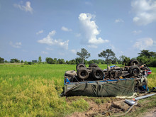Inverted Big Truck On Rice Field