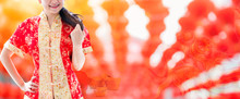 Happy Chinese New Year. Asian Woman With Copy Space  And Red Lanterns Blur Background