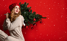 Young Woman Hold Winter Christmas Fir Tree Decoration In Knitted Hat Under Snow. New Year Concept