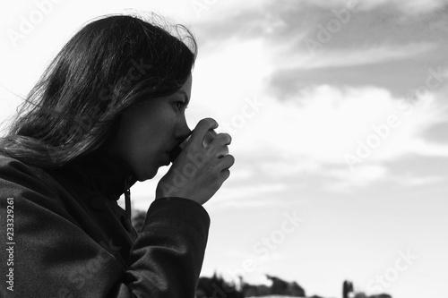 Fotografie, Obraz  Woman is drinking tea on the waterfront