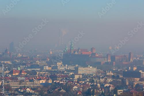 Fotografie, Obraz Dense smog over the city, aerial view of Krakow, Poland