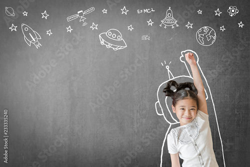 Kid's learning inspiration in science education with girl child's imagination doodle on teacher's school chalkboard for back to school month concept