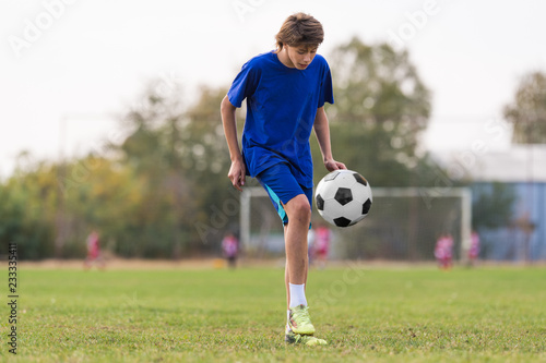 Young children player on the football match