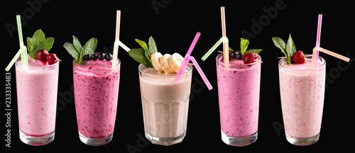 A set of milkshakes and smoothies in glasses. On a black background