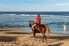 Girl Riding Horse On The Beach...