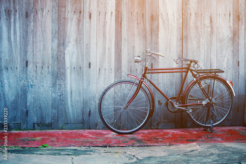 Vintage bycicle near old house at countryside in Thailand
