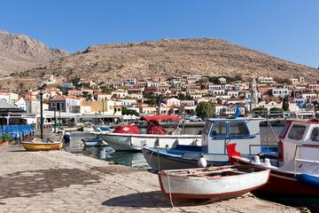 Fototapeta na wymiar Halki, Emporio village harbour, Aegean sea, Dodecanese Islands, Greece
