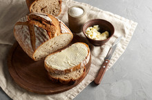 Artisan Sliced Toast Bread With Butter And Sugar On Wooden Cutting Board