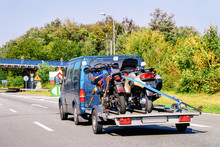 Mini Van With Motorcycles On Trailer In Road Slovenia