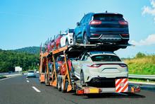 Cars Carrier Truck On Asphalt Highway In Poland