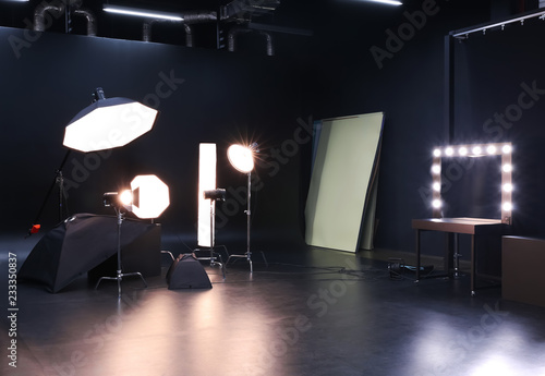 Interior of modern photo studio with professional equipment Fotobehang