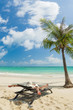 white sandy beach young woman relaxing on sunbed on sunny tropical paradise island