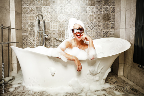 Foto Woman in bath and towel on head.