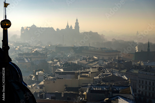 Fototapeta Aerial view of the south part of the Krakow with Wawel castle and Royal Archcathedral Basilica of Saints Stanislaus and Wenceslaus.View from St. Mary's Cathedral. Poland. 10-12-2015 obraz