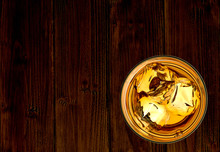 Whiskey Or Whisky In Rocks Glass On Wooden Table From Top View Isolated On White Background