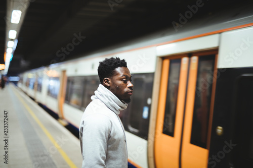 Man waiting for the train doors to open