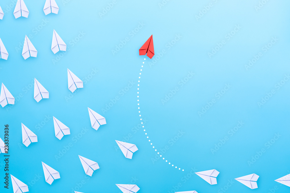 Fototapety, obrazy: Group of white paper plane in one direction and one red paper plane pointing in different way on blue background. Business concept for new ideas, creativity, innovation and solution.