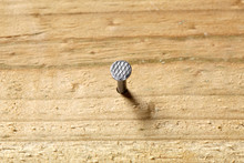 Nail Fixed In A Wooden Board