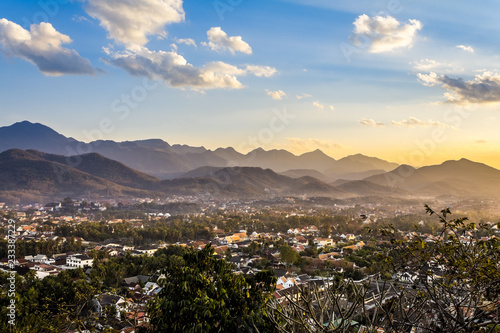 Spoed Foto op Canvas Grijze traf. Landscape view over the city in the sunset lights from Mount Phousi, Laos
