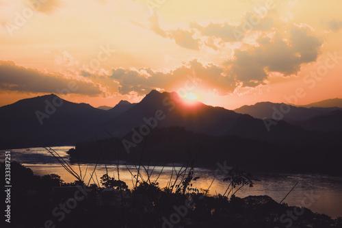 Foto op Aluminium Chocoladebruin Beautiful sunset view over Mount Phousi, Luang Prabang, Laos