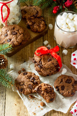 Fototapeta Baked Christmas cookies. Homemade Chocolate Chip Cookies on a wooden table.