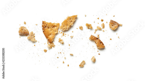 Valokuvatapetti Scattered crumbs of cookie or cracker isolated on white background