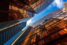 Abstract Perspective Golden Lighting On Buildings And Blue Sky