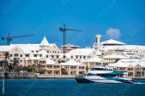 Ferry cruising along the waterfront of Hamilton, Bermuda.