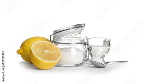 Composition with vinegar, lemons and baking soda on white background