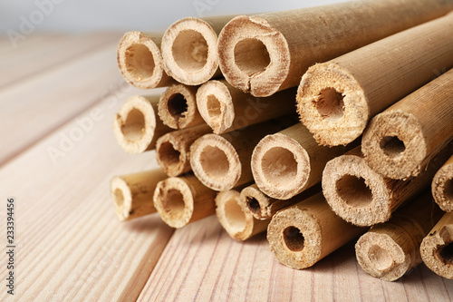 Pile of dry bamboo sticks on wooden table