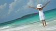 Latin American girl walking barefoot by tropical ocean
