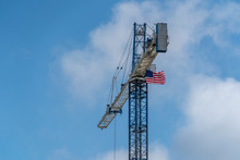 Big Crane With American Flag S...