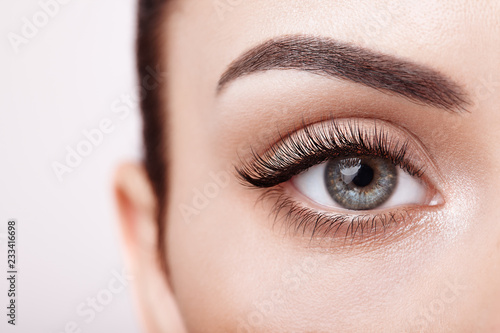 фотография  Female eye with long false eyelashes