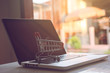 Shopping online concept - Shopping service on The online web. offers home delivery. Empty shopping cart on a laptop keyboard