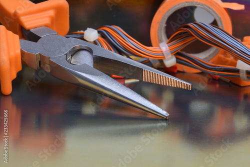 Electrical tool and components on metallic background
